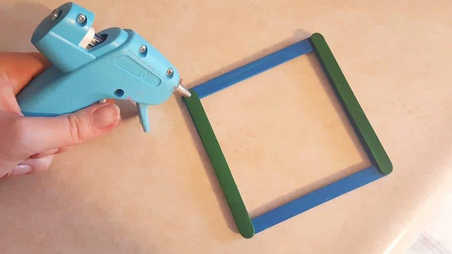 DIY Bird Feeder - Earth Day Craft Sticks Craft for Kids