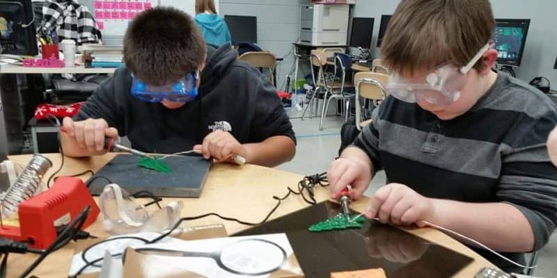 middle school students soldering